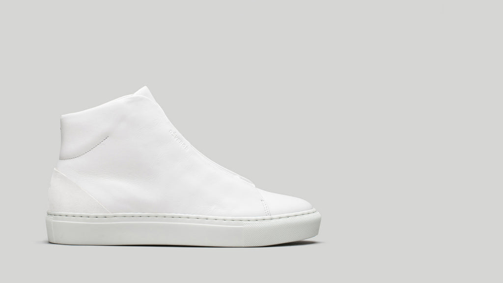 Side view of the DiVERGE Minimal High White Canvas sneakers/trainers