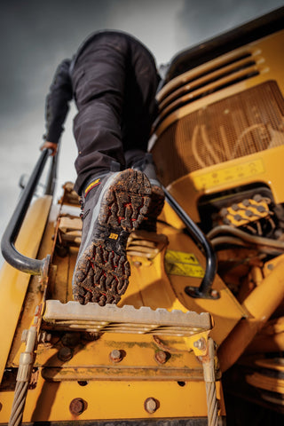 An image of Caterpillar Boots being modelled