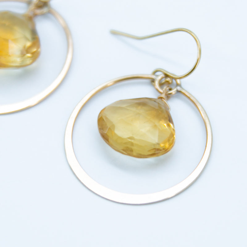 Earring with flattened circle and stone