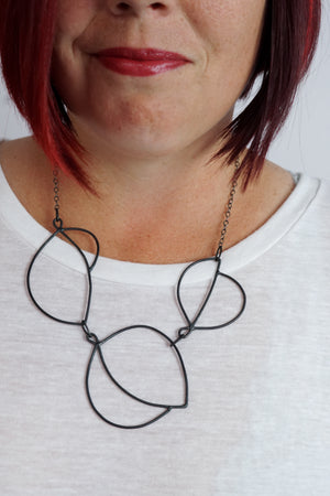 Embiller Necklace in steel, silver, or bronze
