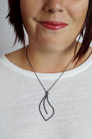 Flourish Necklace in black steel, silver, or bronze