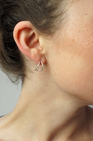tiny curve post earrings in silver