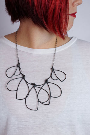 Voler Necklace in steel, silver, or bronze