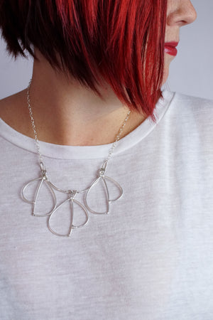 Trivolo Necklace in steel, silver, or bronze