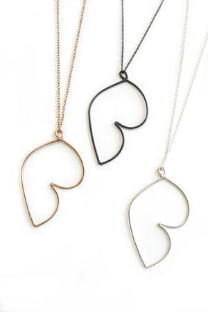 Matisse inspired jewelry - bronze, black, and silver pendants