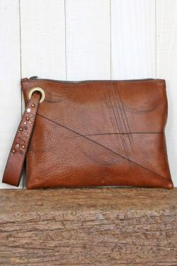 Genuine leather clutch with studded wristlet
