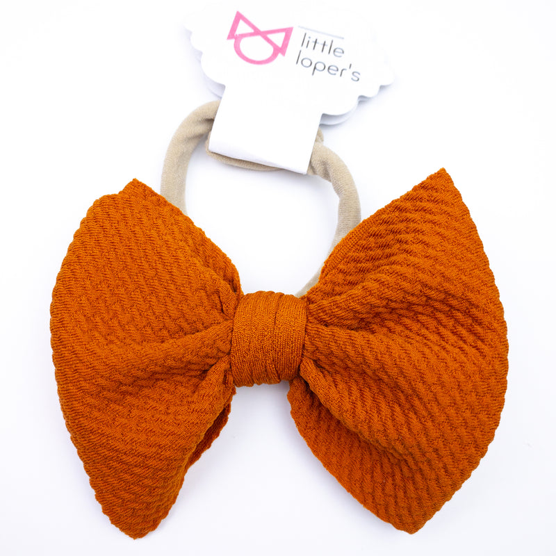 bright orange baby bow