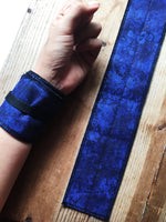 Blue galaxy style glitter wrist wraps for crossfit weightlifting