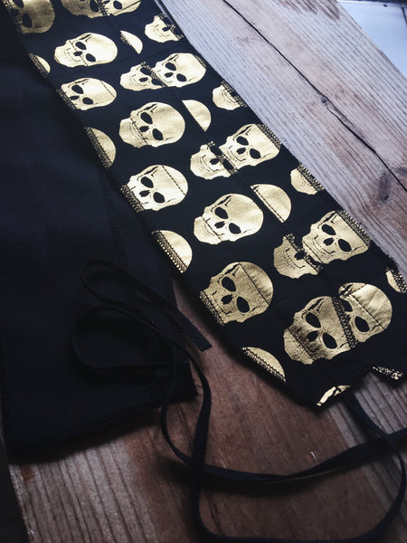 Metallic skulls wrist wraps
