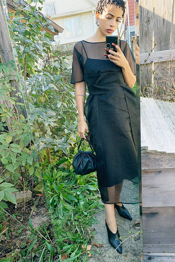 Shaina Mote sheer silk gia dress in black, shot with the ARE studio lucille bag and Dubie punta heel