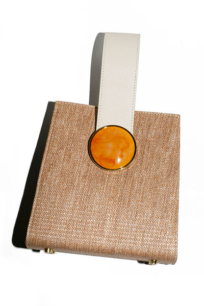 Lizzie Fortunato handbag in woven fabric, smooth cream leather and orange acrylic details.