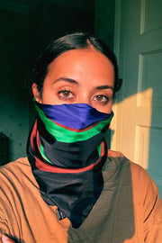 rodebjer swirl silk scarf worn as a mask/face covering
