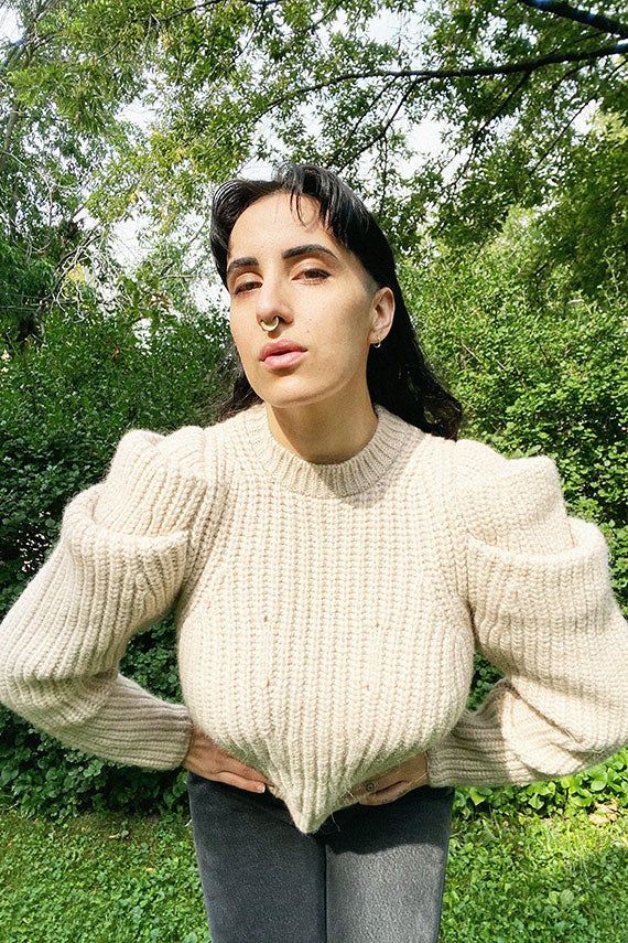 Ulla Johnson daphne pullover on a model in a natural setting