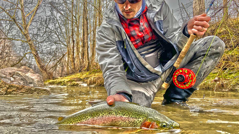 20 Top Trout Flies for October - Man Catching Large Trout