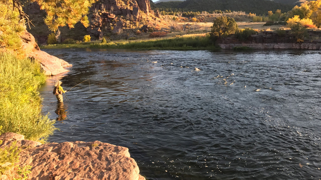 man fishing on a river in utah