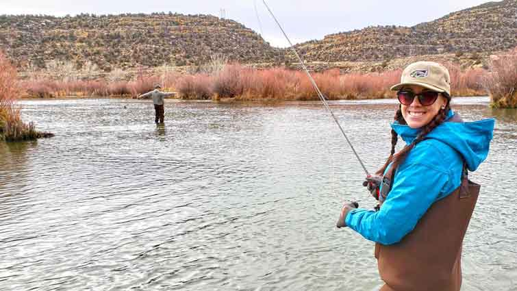 Do You Need Tippet to Fly Fish?  Women fly fishing in River in Colorado