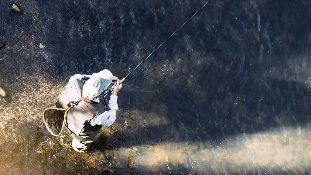 Man Fly Fishing with Rod Tip Down
