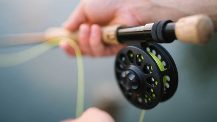 Picture of Fly Reel in Mans Hands