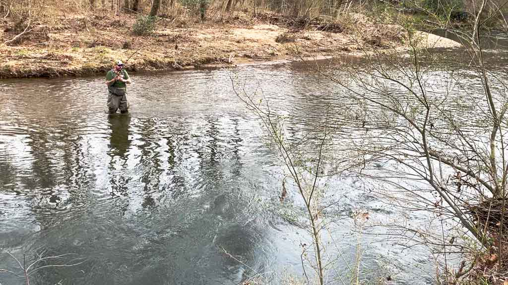 Man in Fast Moving Water Fly Fishing