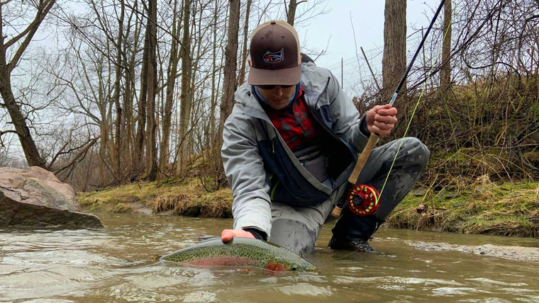 Man Catching Large Trout