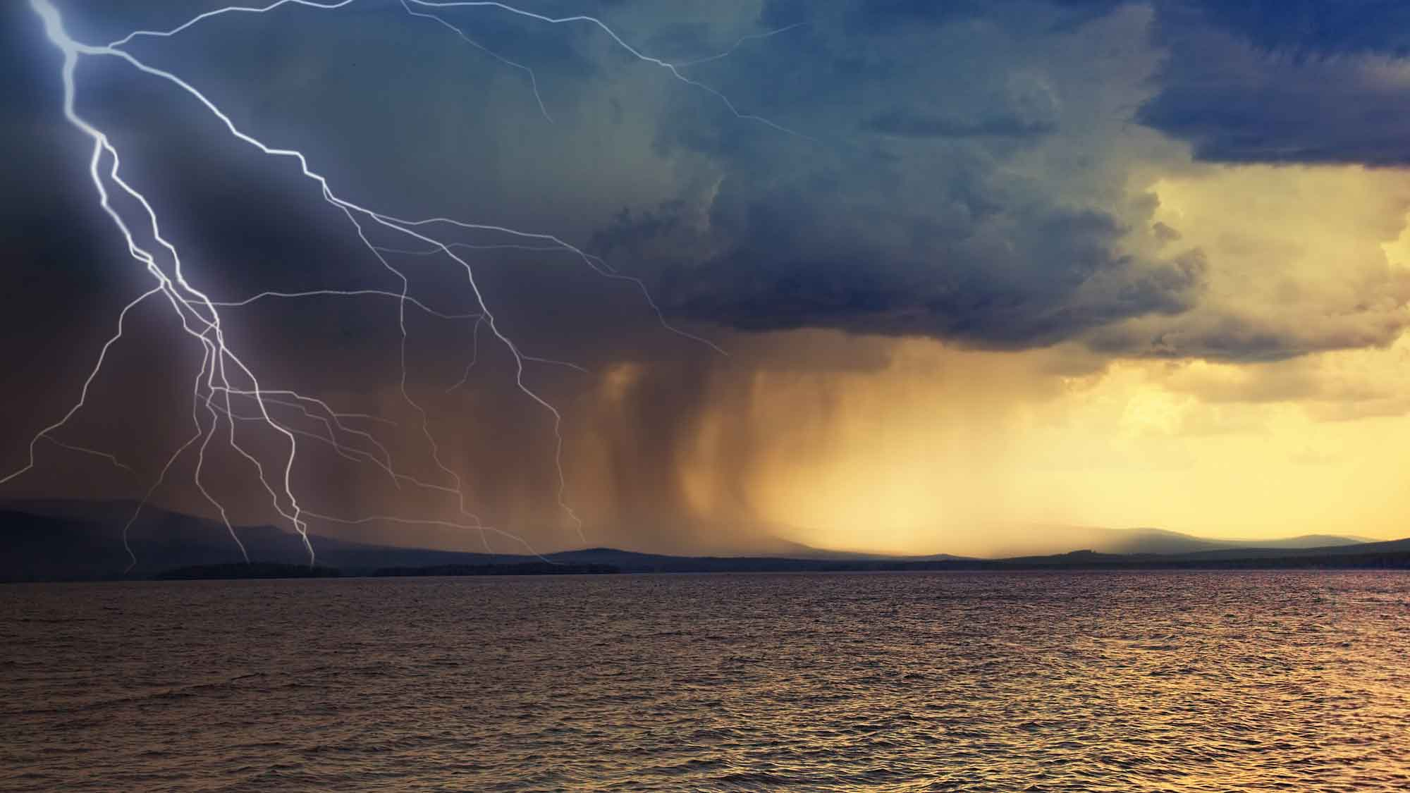 Storm over lake with lightning