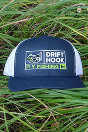 Drifthook Trucker Cap—Blue with Box Logo In Grass