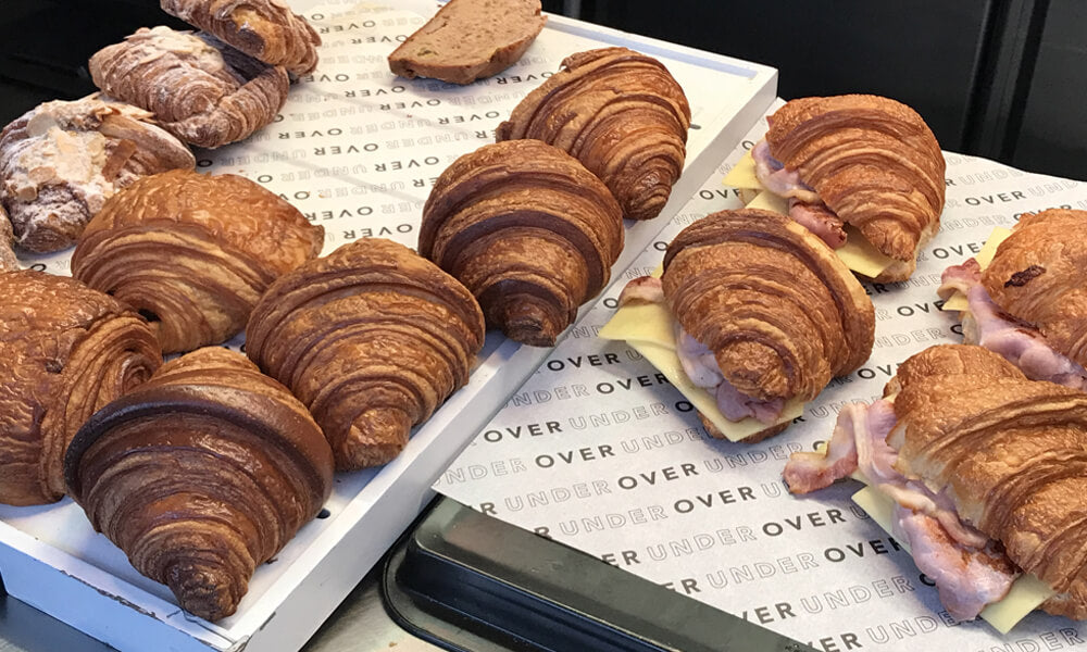 custom printed greaseproof paper with pastries on top