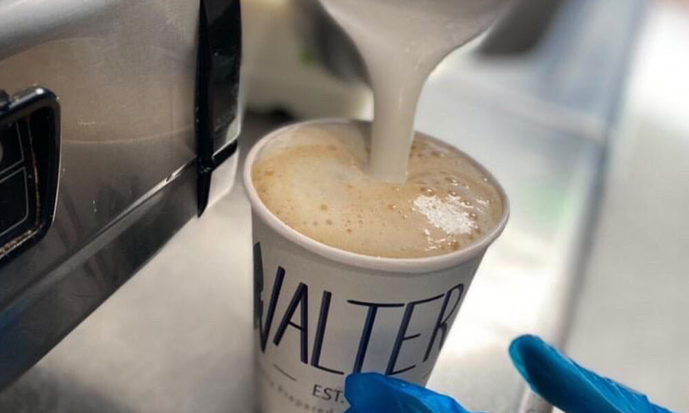 walters custom branded coffee cups pouring coffee