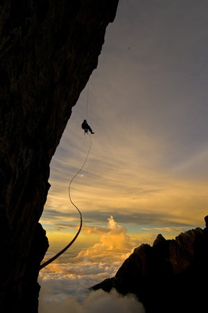 Rappeling at sunset, Borneo