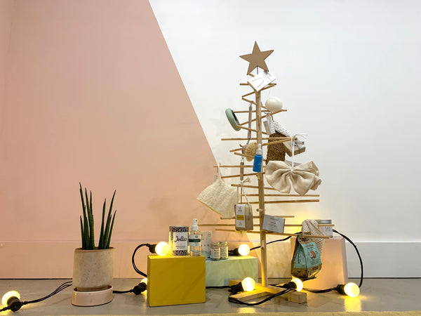 wooden homemade Christmas tree full of gifts