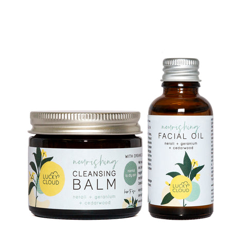 lucky cloud cleansing balm and face oil in amber glass jars and bottles with metal lids.