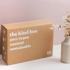 brown cardboard box with white writing on it the kind box ethical vegan and sustainable.