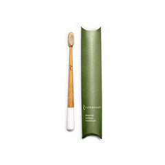 White tipped bamboo toothbrush with green cardboard pillow packet.