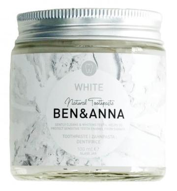 Natural whitening toothpaste in a glass jar with a metal lid by ben and anna.