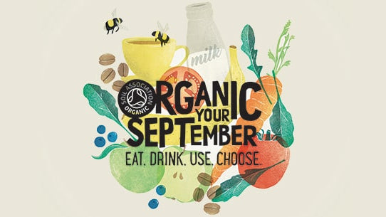 organic september logo organic your september with fruit and vegetables behind text.