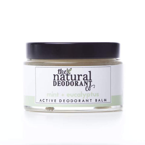 natural deodorant in glass jar with metal lid.