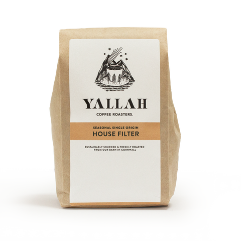yallah coffee in brown paper bag with label.