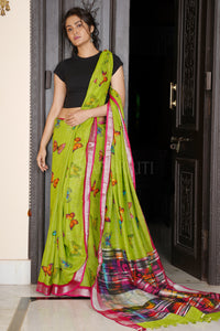 GREEN BUTTERFLY PRINTED LINEN SAREE WITH DEEP PINK ZARI BORDER