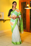 WHITE HANDLOOM SAREE WITH GREEN AND ORANGE EMBROIDERY AND GREEN BORDER
