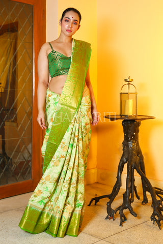 OFF-WHITE PRINTED DUPION SILK SAREE WITH GREEN ZARI BORDER AND PALLU
