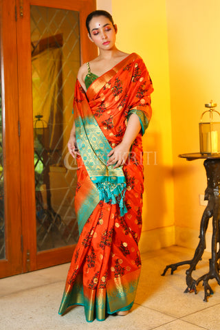 ORANGE FLORAL PRINTED DUPION SILK SAREE WITH SKY BLUE ZARI BORDER AND PALLU