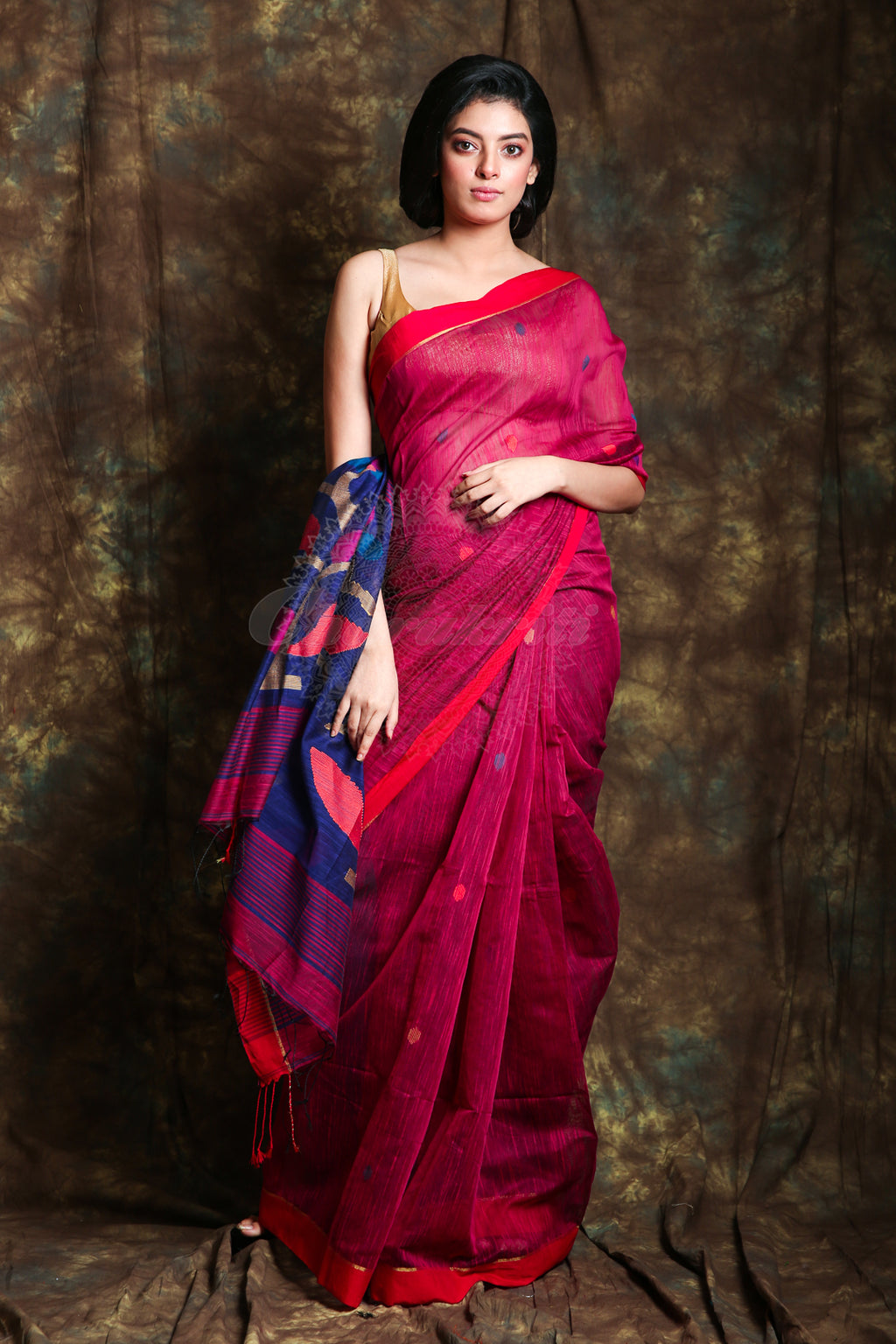 The Blended Cotton Based Deep Pink Color Saree Have Polka Dot Weaving All Over. The Pallu Have Navy Blue Color Floral Weaving And Red Border - Charukriti.co.in