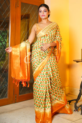 OFF-WHITE FLORAL PRINTED DUPION SILK SAREE WITH ORANGE ZARI BORDER AND PALLU