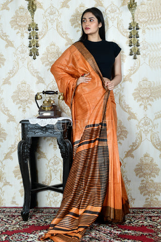 RUST ORANGE GHEECHA WITH BLACK  BORDER AND PALLU