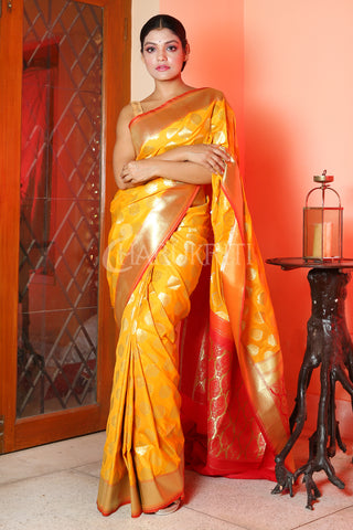 YELLOW BANARASI SAREE WITH ALL OVER ZARI WORK AND RED PALLU