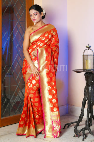 FIERY ORANGE BANARASI SAREE WITH ALL OVER ZARI WORK AND PINK PALLU