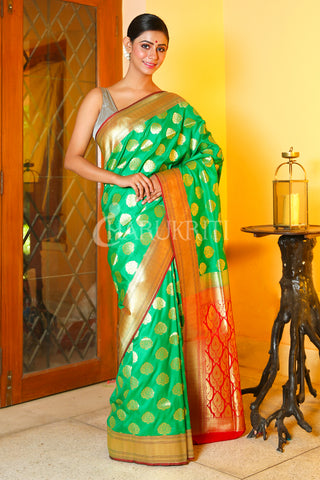 JADE GREEN BANARASI SAREE WITH ALL OVER ZARI WORK AND RED PALLU
