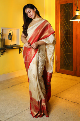 OFF WHITE MANIPURI KATKI GARDWAL SAREE WITH RED ZARI BORDER AND PALLU