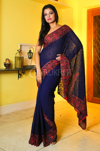 BLUE CHIFFON SAREE WITH SELF EMBROIDERED AND FLORAL JARDOSI BORDER