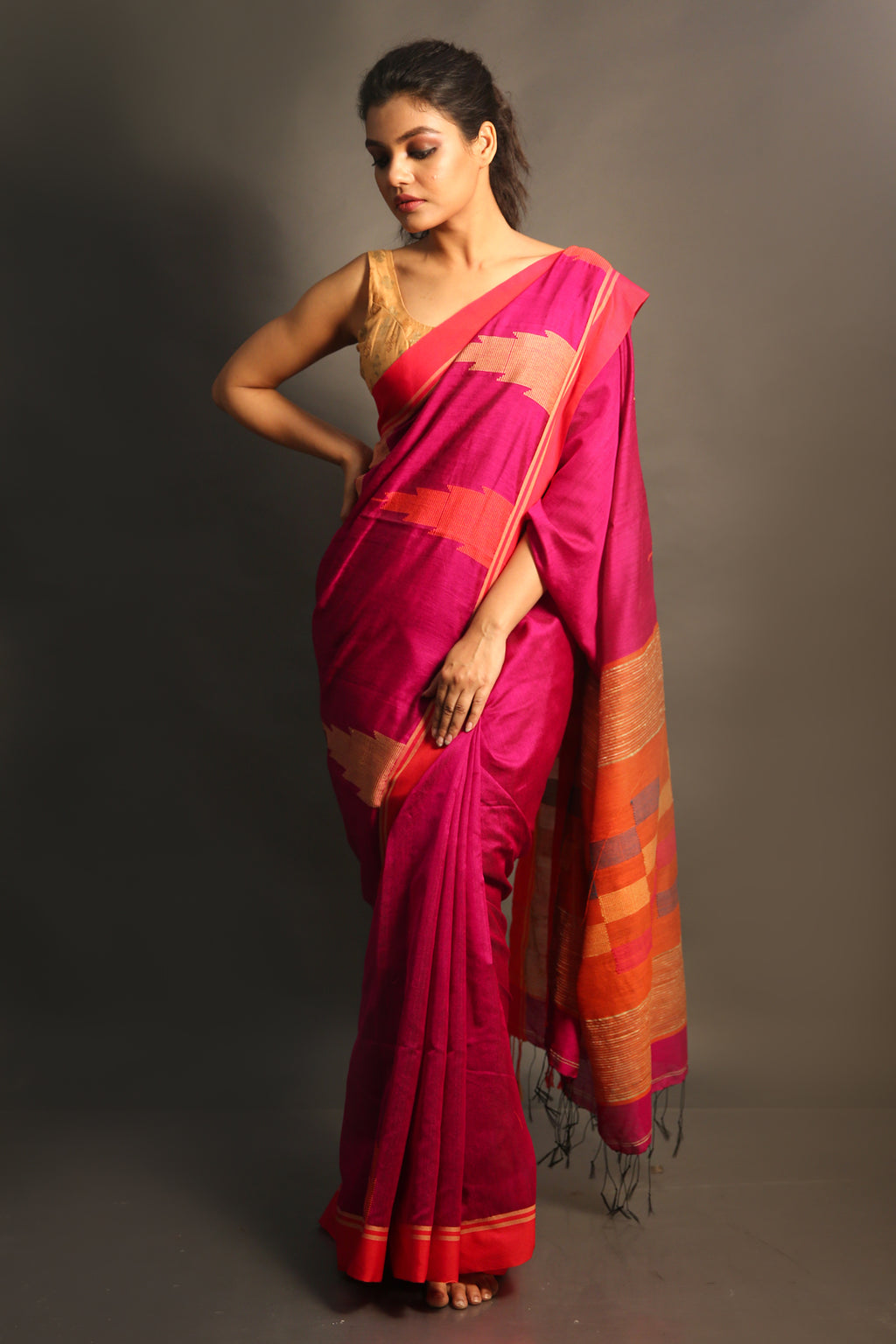 This Fuchsia Handloom Saree Is Crafted In Cotton, Features Thread Tassel Details On The Pallu And Comes With An Unstitched Blouse Piece. Style This Saree With Statement Accessories And A Pair Of High Heels To Complete The Look - Charukriti.co.in